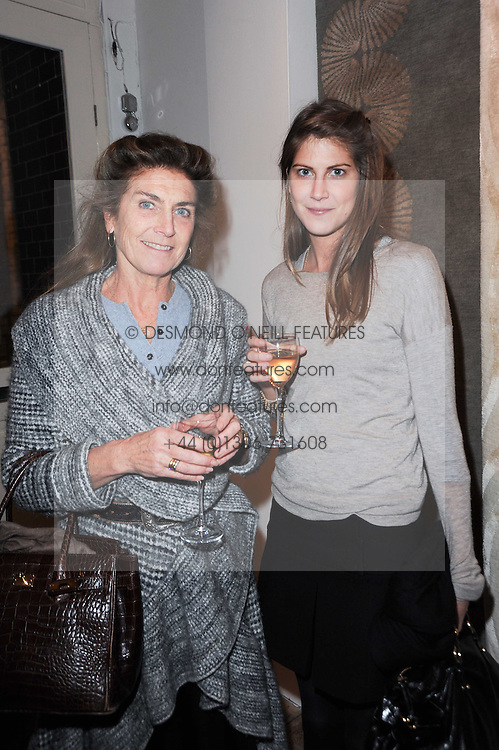 Left to right, PRINCESS VICTORIA VON PREUSSEN and her daughter PRINCESS FLORENCE VON PREUSSEN at the opening of Luke Irwin's showroom at 22 Pimlico Road, London SW1 on 24th November 2010.
