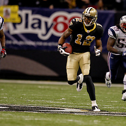 2009 November 30:  New Orleans Saints wide receiver Marques Colston (12) runs after a catch in the second half during a 38-17 win by the New Orleans Saints over the New England Patriots at the Louisiana Superdome in New Orleans, Louisiana.