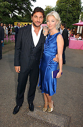 TAMARA BECKWITH and GEORGE VERONI at the Serpentine Gallery Summer party sponsored by Yves Saint Laurent held at the Serpentine Gallery, Kensington Gardens, London W2 on 11th July 2006.<br />