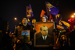 January 1, 2018 - Kiev, Ukraine - A girl carry the portrait of Stepan Bandera during the rally. Supporters and members of different far right nationalistic movements and parties participate an annual torch march downtown Kyiv confined to the 109th birthday of Ukrainian nationalism ideologist and insurgent army commander Stepan Bandera, Kyiv, Ukraine, Jan.1, 2018. (Credit Image: © Sergii Kharchenko/NurPhoto via ZUMA Press)