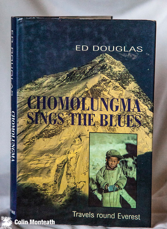 CHOMOLUNGMASINGS THE BLUES,  Ed Douglas, Constable, London, 1997 1st Uk edn., 226 page VG hardback in VG jacket, B&W plates, maps, A sensitive account of the issues facing the Nepalese and Tibetans living in the shadow of Chomolungma - Douglas is arguably the best journalist (and a climber) on the Himalaya today - $55