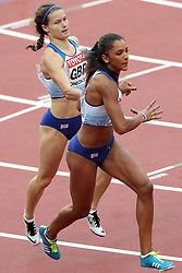 Great Britain's Laviai Nielsen receives the baton from Zoey Clark in the Women's 4x400m Relay during day nine of the 2017 IAAF World Championships at the London Stadium.