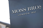 Sign for suits and formal Menswear shop Moss Bross.