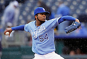 Kansas City Royals pitcher Ervin Santana throws the ball in the first inning of a baseball game against the Tampa Bay Rays at Kauffman Stadium in Kansas City, Thursday, May 2, 2013.  (AP Photo/Colin E. Braley).
