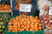 Marmalade oranges on sale market stall three pound weight for £2.00 sterling
