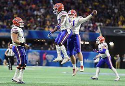 Florida Gators defensive back Austin Perry (47) and Florida Gators linebacker James Houston IV (41) react after a play during the Chick-fil-A Bowl Game at  the Mercedes-Benz Stadium, Saturday, December 29, 2018, in Atlanta. ( Kyle Hess via Abell Images for Chick-fil-A Kickoff)