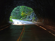 Looking out from inside the Cowlitz Box Canyon tunnel in Mount Rainier National Park, WA, USA