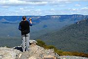 Tourist videoing the view. Katoomba, Blue Mountains, Australia