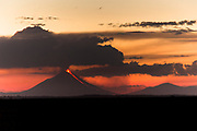 Landscape with view of the Momotombo volcano during eruption under a moody sky at sunset, Nicaragua