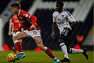 Marley Watkins of Barnsley (L) takes on Floyd Ayite of Fulham (R). EFL Skybet championship match, Fulham v Barnsley at Craven Cottage in London on Saturday 23rd December 2017<br /> pic by Steffan Bowen, Andrew Orchard sports photography.<br /> contact and payments to Andrew Orchard, 2 Old Vicarage close, Pengam, Blackwood, Gwent. NP12 3TU. Tel 07974 069129.  vat reg no 615 9784 04,  <br /> no unpaid use, All usage chargeable.