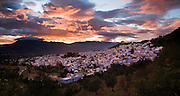 The town of Chefchaouen, Morocco, at the base of the Rif Mountains, glistens at sunset on October 28, 2007.