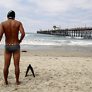 OCEANSIDE, CA, August 21, 2004: Participant waits to enter the water to compete in the World Bodysurfing Championship in Oceanside, California.