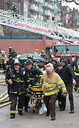 Mar 26, 2014 - Boston, Massachusetts, U.S. - <br /> <br /> Two Firefighters Killed in Boston Brownstone Blaze<br /> <br /> More than 150 Boston Firefighters battle a fast moving fire on Beacon Street where more than 15 individuals were transported from the scene to local hospitals. Seriously hurt firefighters are reported to be among those injured. <br /> ©Exclusivepix
