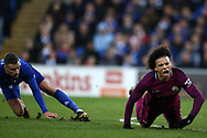 Leroy Sane of Manchester city is fouled by Joe Bennett of Cardiff city (l). The Emirates FA Cup, 4th round match, Cardiff city v Manchester City at the Cardiff City Stadium in Cardiff, South Wales on Saturday 28th January 2018.<br /> pic by Andrew Orchard, Andrew Orchard sports photography.