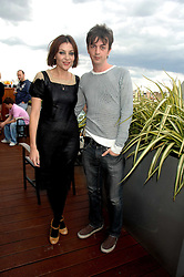 PEARL LOWE and  DANNY GOFFEY at a party to celebrate the publication of 'All That Glitters' by Pearl Lowe held at the May Fair Hotel, London on 8th July 2007.<br />