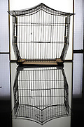 empty metal wire birdcage house