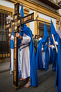 To enhance the act of penance, some worshippers sperform the whole path, that can be several kilometres long, barefoot and carrying chains. Cordoba, Spain.