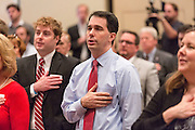 Wisconsin Governor and potential Republican presidential candidate Scott Walker stands for the pledge during a GOP lunch event March 20, 2015 in Charleston, South Carolina.