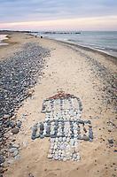 Artwork in sand made of stones Whitefish Point beach Michigan