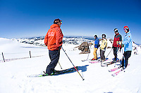Ski instructor giving lesson to group at Kirkwood ski resort near Lake Tahoe, CA.<br />