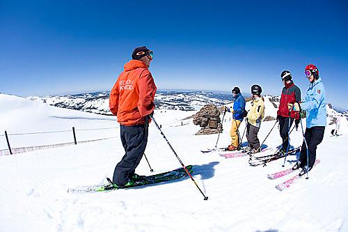 Ski instructor giving lesson to group at Kirkwood ski resort near Lake Tahoe, CA.<br />