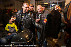 Checking out the leathers at the Mr. Martini Friday night party celebrating the opening of his bar / restaurant at the workshop during the Motor Bike Expo. Verona, Italy. January 22, 2016.  Photography ©2016 Michael Lichter