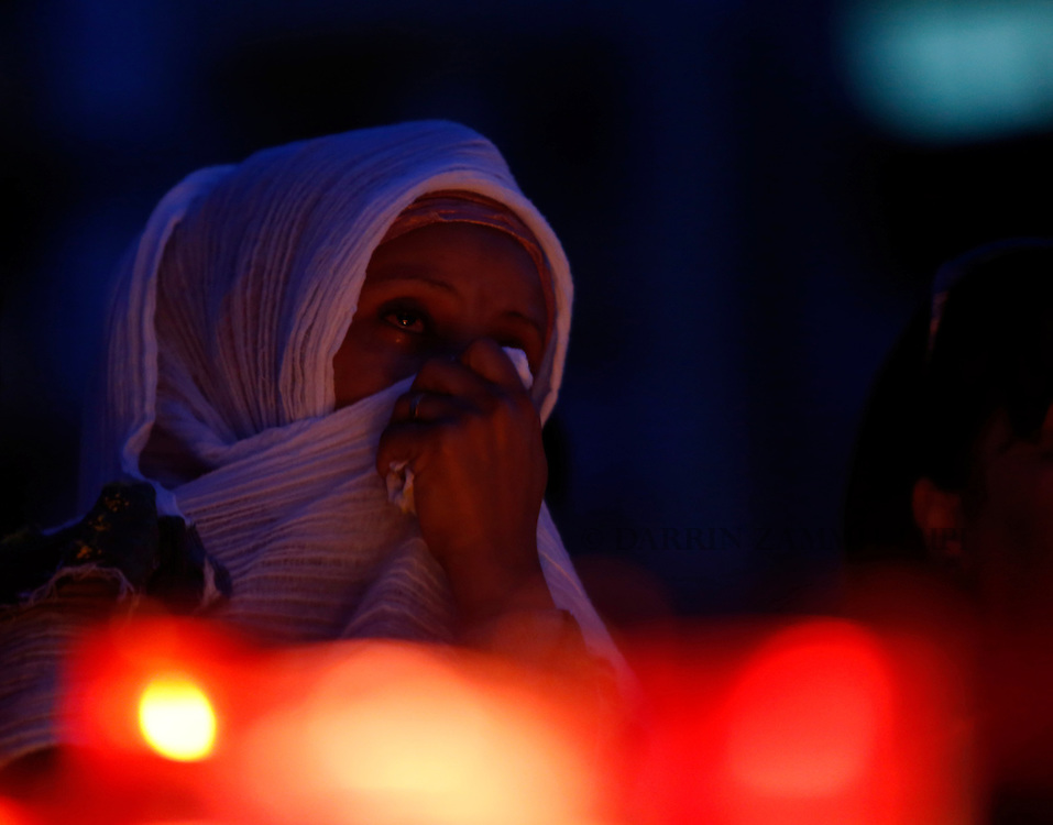 A migrant cries during a candlelight vigil to commemorate migrants who died at sea in Sliema, outside Valletta, April 22, 2015. European Union leaders who decided last year to halt the rescue of migrants trying to cross the Mediterranean will reverse their decision on Thursday at a summit hastily convened after nearly 2,000 people died at sea.  Public outrage over the deaths peaked this week after up to 900 migrants died last Sunday when their boat sank on its way to Europe from Libya. <br /> REUTERS/Darrin Zammit Lupi MALTA OUT. NO COMMERCIAL OR EDITORIAL SALES IN MALTA
