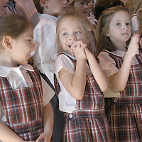 Dani Loya, 5, looks at Victoria Way, 5, as Morgan Feanny, 5, claps after their performance during the dedication ceremony at River Oaks Baptist School for the Nancy Heath Hightower Education Building, 01/28/04.  (Photo by Kim Christensen)
