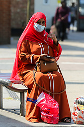 © Licensed to London News Pictures. 20/07/2021. London. UK. A shopper wearing a face covering rests outside Aldi supermarket in Tottenham, north London on the day after Freedom Day. Face coverings are no longer a legal requirement, but the government expects and has recommended that people should continue to wear face coverings whilst shopping and in crowded areas, such as public transport. Photo credit: Dinendra Haria/LNP