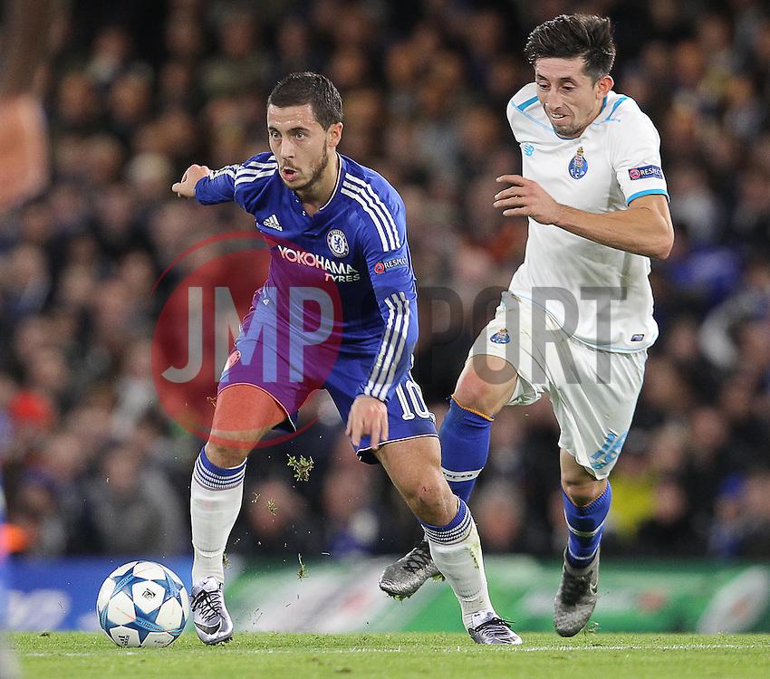 Eden Hazard of Chelsea and Hector Herrera of FC Porto challenge for the ball - Mandatory byline: Paul Terry/JMP - 09/12/2015 - Football - Stamford Bridge - London, England - Chelsea v FC Porto - Champions League - Group G