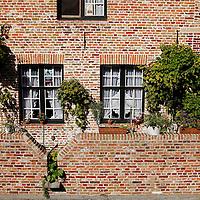 Europe, Belgium, Brugges. Bricks and windows of Brugges.