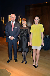 JOANNA WOOD with her husband CHARLES HANSARD and daughter HARRIET HANSARD at a party to celebrate the publication of Interiors For Living by Joanna Wood held at Christie's. 8 King Street, St.James's, London on 2nd March 2015.