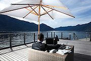 one businessman are relax in front of the lake