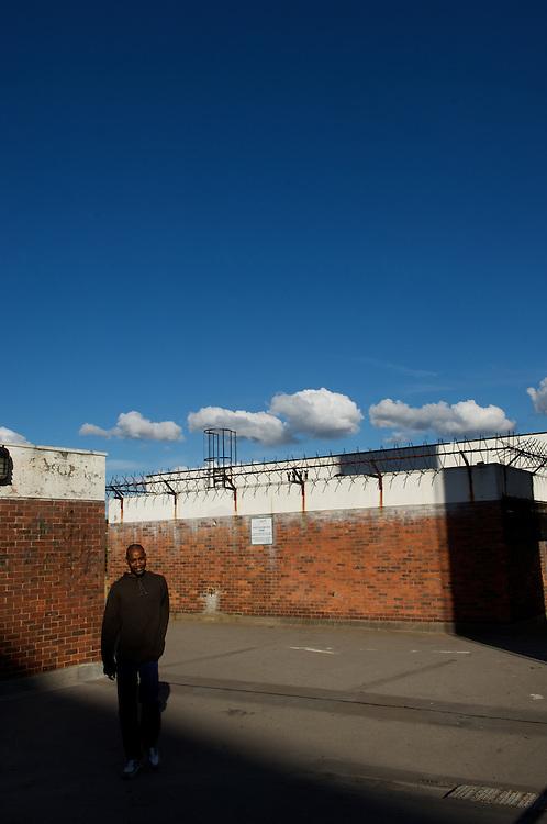 A man strolls through the walkways of Elephant & Castle's Heygate Estate in London.