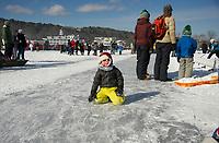 New England Pond Hockey Classic on Meredith Bay.  Karen Bobotas for the Laconia Daily Sun