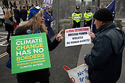 Brexit protesters discuss climate change and nuclear power in Westminster outside Parliament on 8th January 2020 in London, England, United Kingdom. With a majority Conservative government in power and Brexit day at the end of January looming, the role of these protesters is now to demonstrate in the hope of the softest Brexit deal possible.