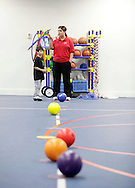 Monroe, New York - A staff member gets ready to start a game for children at the new South Orange Family YMCA on Wednesday, Feb. 16, 2011. ©Tom Bushey / The Image Works