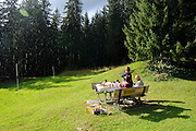 Raining on a Family picnic in a forest in the Dolomites, Italy