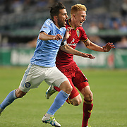 NEW YORK, NEW YORK - June 02: David Villa #7 of New York City FC and Justen Glad #15 of Real Salt Lake challenge for the ball during the NYCFC Vs Real Salt Lake regular season MLS game at Yankee Stadium on June 02, 2016 in New York City. (Photo by Tim Clayton/Corbis via Getty Images)