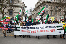 London, UK. 16th March, 2019. Members of the Syrian community opposed to President Assad march in Whitehall to mark the 8th anniversary of the start of the Syrian Revolution.