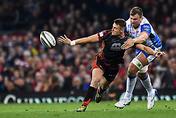 27th April 2019 , Principality Stadium , Cardiff, Wales ; Guinness pro 14's, Round 21, Dragons vs Scarlets ; Josh Lewis of Dragons offloads despite the tackle of Dave Bullbring of Scarlets<br /> <br /> Credit :  Craig Thomas/Replay Images