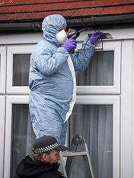 © Licensed to London News Pictures. 04/04/2018. London, UK. Forensics attempt to recover a bullet from the window frame of a property on Chalgrove Road in Tottenham, north London where 17 year old Tanesha Melbourne was shot dead. A recent spree of killings in the capital has taken the murder toll for the year so far to 48. Photo credit: Ben Cawthra/LNP