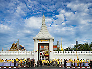 09 JUNE 2016 - BANGKOK, THAILAND:  Thais gather in front of Wat Phra Kaew and the Grand Palace before a special merit making ceremony Thursday. Thailand marked 70 years of the reign of Bhumibol Adulyadej, the King of Thailand, with a special alms giving ceremony for 770 monks in front of the Grand Palace in Bangkok. The King, also known as Rama IX, ascended the throne on 9 June 1946. He is the longest serving monarch in Thai history and the longest serving monarch in the world today. He is revered by most Thais and is widely seen as a unifying figure in the country.    PHOTO BY JACK KURTZ