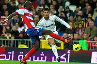 20120107: MADRID, SPAIN - BBVA League: Football macht between Real Madrid C.F vs Granada in Santiago Bernabeu, Madrid, Spain.<br /> In photo: Cristiano Ronaldo(L) in action with the ball.<br /> PHOTO: CITYFILES