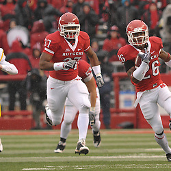 Dec 5, 2009; Piscataway, NJ, USA; Rutgers cornerback Joe Lefeged (26) returns a kickoff for a touchdown during second half NCAA Big East college football action in West Virginia's 24-21 victory over Rutgers at Rutgers Stadium.