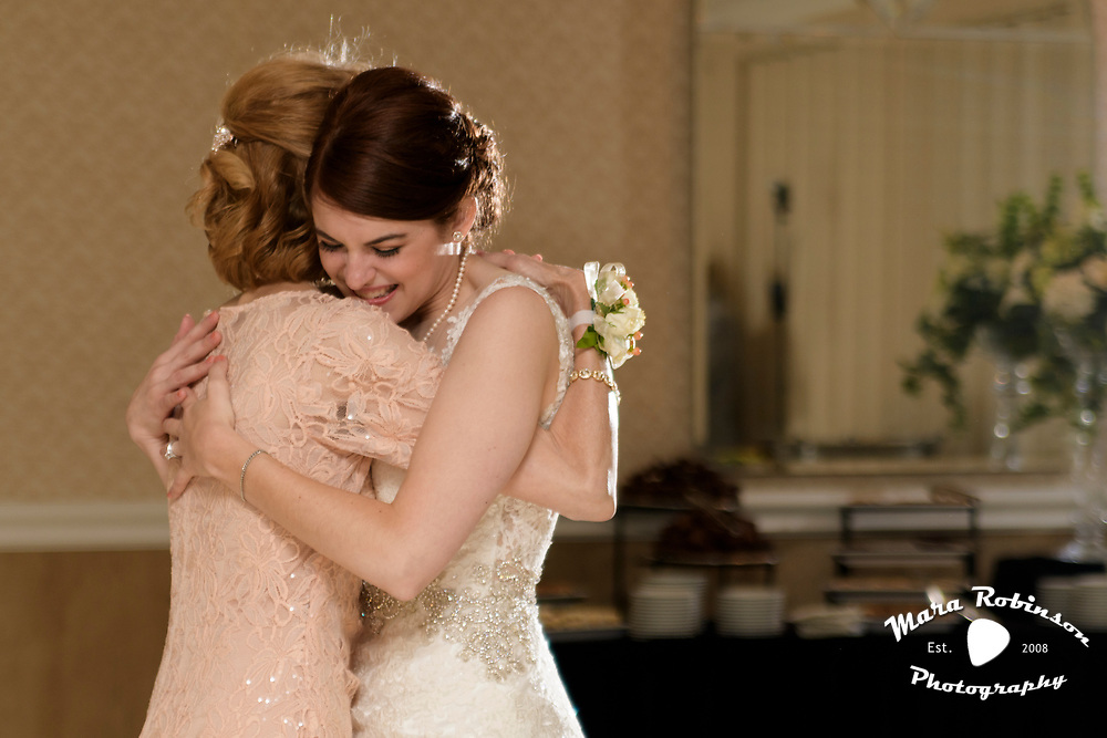 bride and mom hugging by Tallmadge wedding photographer, Akron wedding photographer Mara Robinson Photography