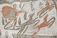Hunter awith dogs chasing a fox from the Room of The Small Hunt, no 25 - Roman mosaics at the Villa Romana del Casale which containis the richest, largest and most complex collection of Roman mosaics in the world, circa the first quarter of the 4th century AD. Sicily, Italy. A UNESCO World Heritage Site. .<br /> <br /> If you prefer to buy from our ALAMY PHOTO LIBRARY  Collection visit : https://www.alamy.com/portfolio/paul-williams-funkystock/villaromanadelcasale.html<br /> Visit our ROMAN MOSAICS  PHOTO COLLECTIONS for more photos to buy as buy as wall art prints https://funkystock.photoshelter.com/gallery/Roman-Mosaics-Roman-Mosaic-Pictures-Photos-and-Images-Fotos/G00008dLtP71H_yc/C0000q_tZnliJD08