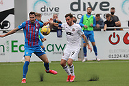Cove Rangers' Mitchel Megginson (9) and Inverness Caledonian Thistle's Kirk Broadfoot (15) battles for possession, tussles, tackles, challenges, during the Premier Sports Scottish League Cup match between Cove Rangers and Inverness CT at Balmoral Stadium, Aberdeen, Scotland on 20 July 2021.