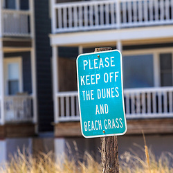 Bethany Beach, DE / USA - April 18, 2015: Please keep off the dunes and beach grass sign in Bethany, Delaware.