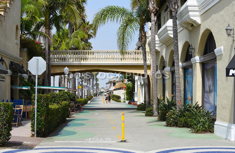 People Walking the Pedestrian Path at the Boardwalk on Balboa Peninsula